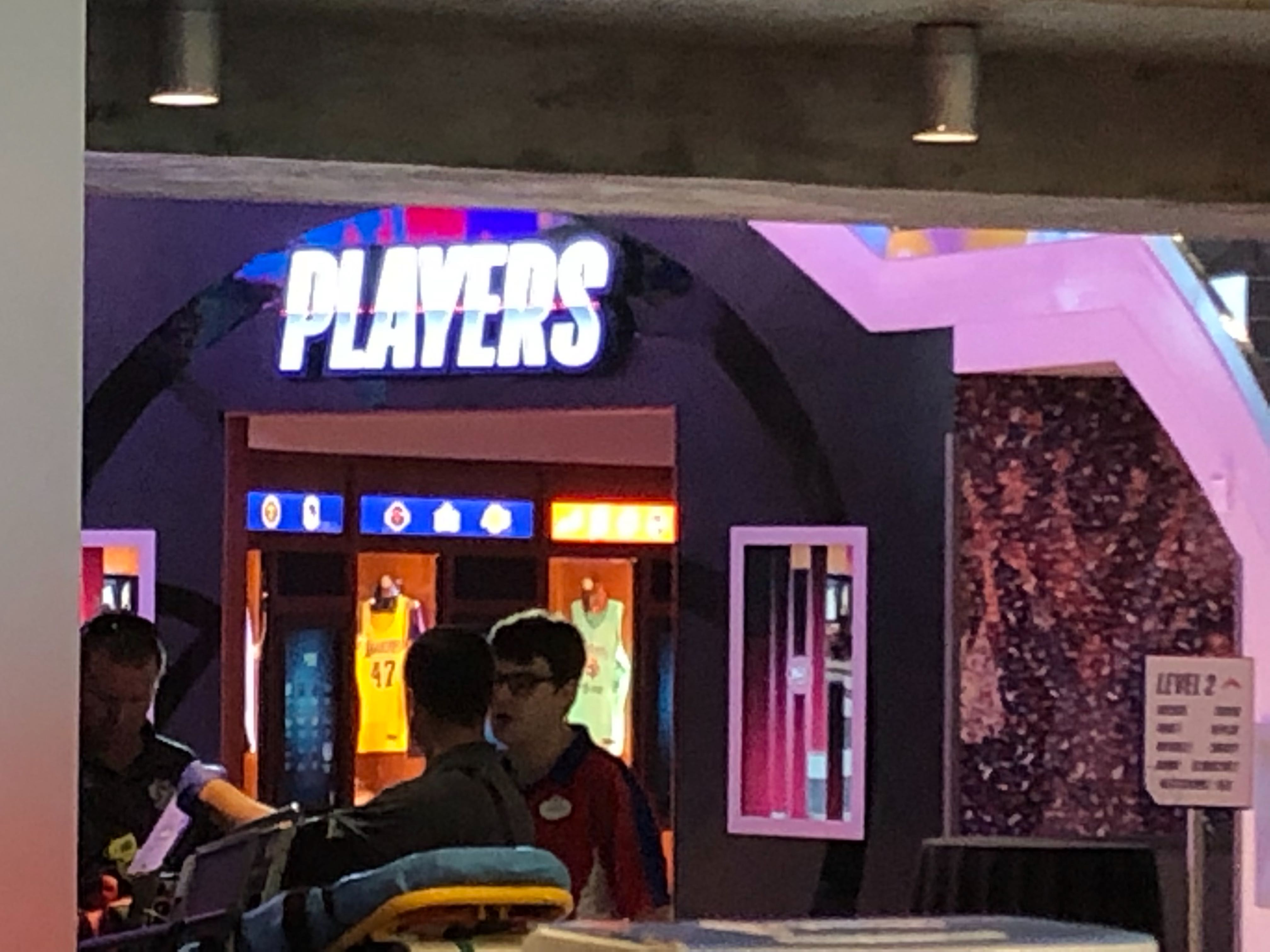 Players light up sign inside NBA Experience