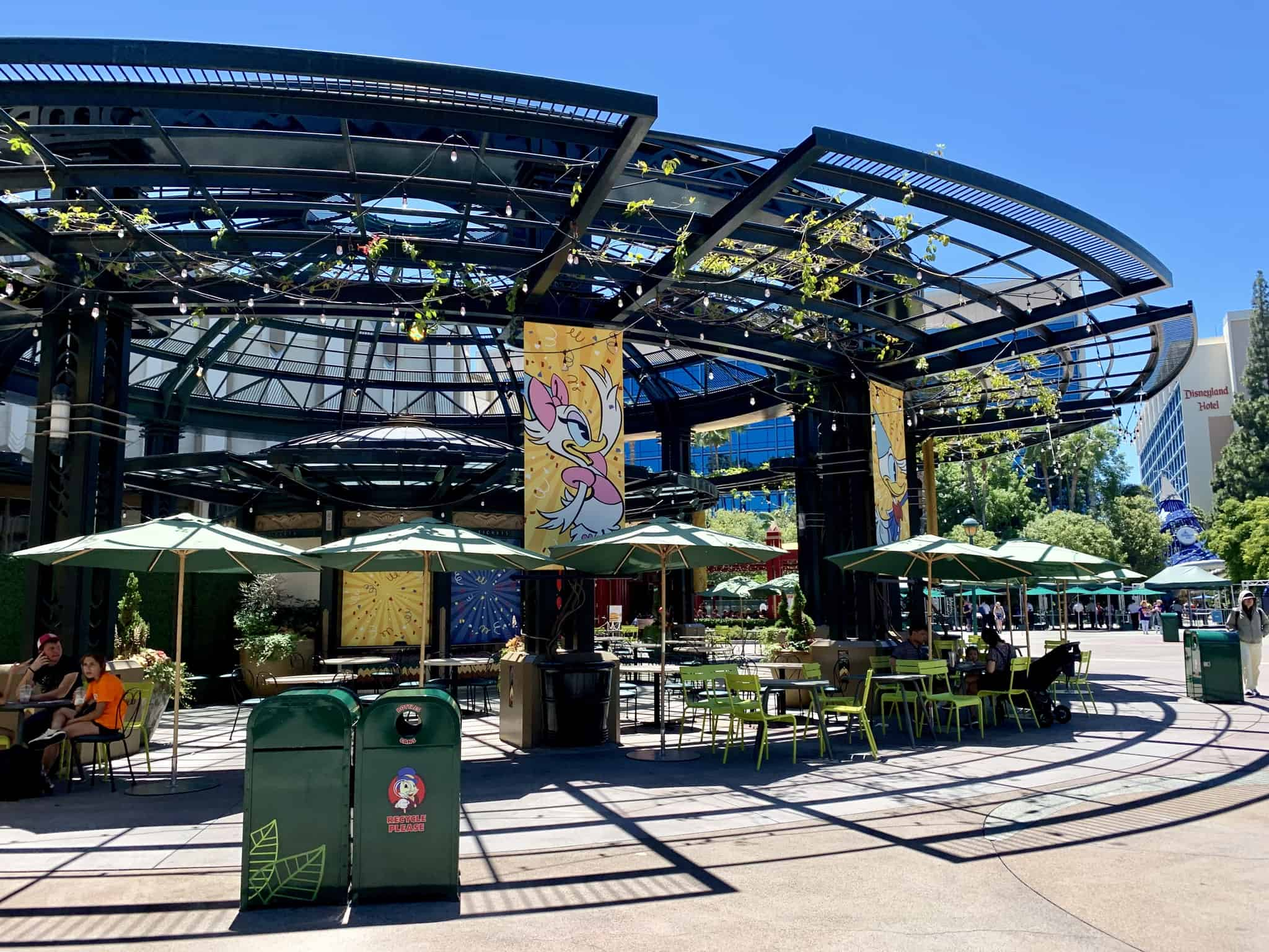 Downtown Disney District July 1 2019 Mickey and Friends Abstract Topiaries, Retro Disney Parks Collage Loungefly, and More