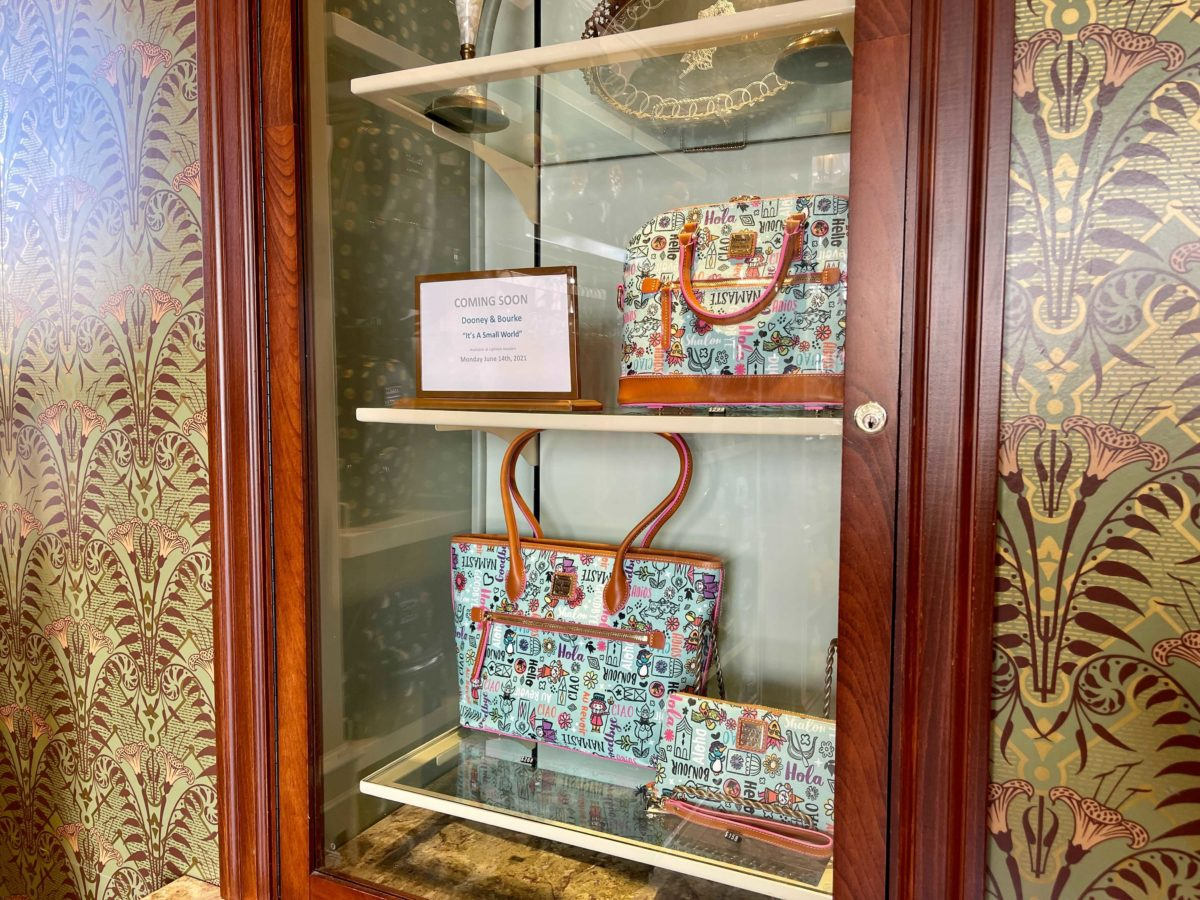 """new dooney & bourke """"it's a small world"""" collection at Uptown Jewelers in the Magic Kingdom at Walt Disney World"""