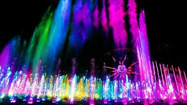 'WORLD OF COLOR' -- Lights, water, music, fire and animation come together like never before in ÒWorld of ColorÓ at Disney California Adventure park in Anaheim, Calif. The show combines nearly 1,200 powerful fountains with heights that range from 30 feet to 200 feet in the air, dazzling colors and a kaleidoscope of audio and visual effects, including both classic and new animation projected on one of the worldÕs largest projected water screens Ñ a wall of water 380 feet wide by 50 feet high for a projection surface of 19,000 square feet . Presented on Paradise Bay in Disney California Adventure park, ÒWorld of ColorÓ is a major milestone in the multi-year expansion of the park. (Paul Hiffmeyer/Disneyland)